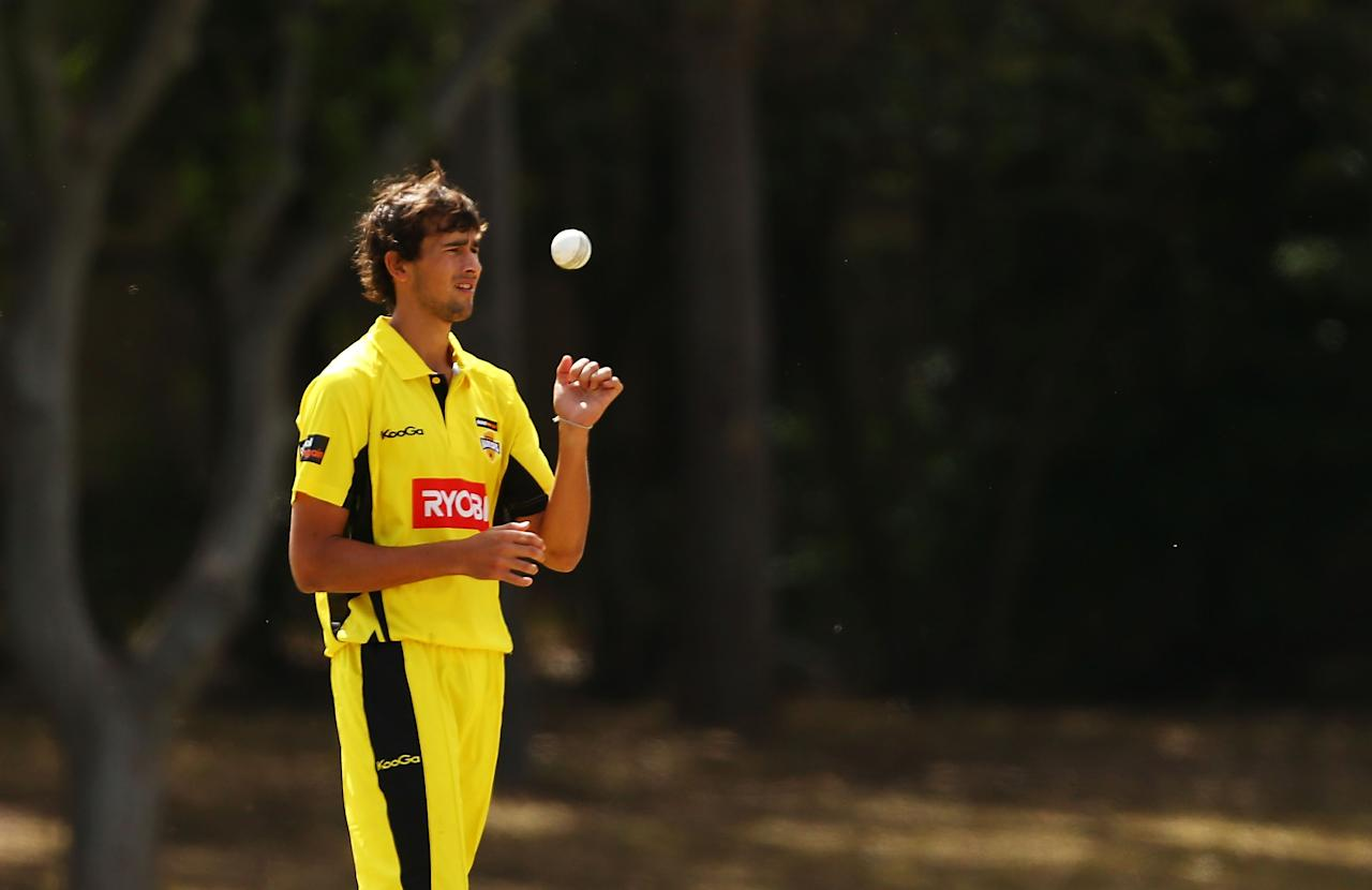 SYDNEY, AUSTRALIA - OCTOBER 11:  Ashton Agar of the Warriors prepares to bowl during the Ryobi Cup match between the Queensland Bulls and the Western Australia Warriors at Bankstown Oval on October 11, 2013 in Sydney, Australia.  (Photo by Matt King/Getty Images)