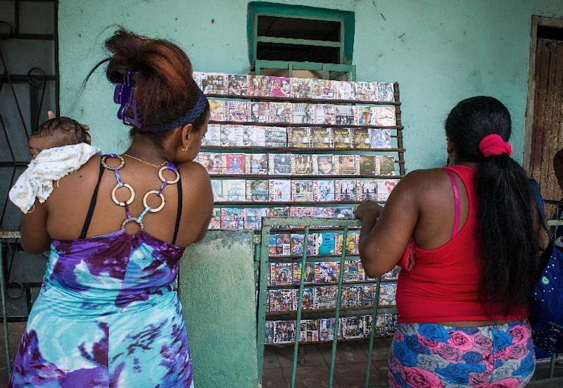 Local women check out compact discs on sale at a private stall in Havana, on September 25, 2014 (AFP Photo/Yamil Lage)