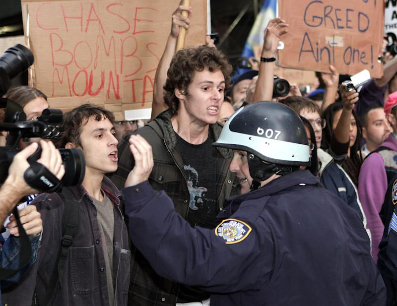 Occupy Wall Street protester clash with police as they arrive at Times Square for a rally Saturday, Oct.  15,  2011. (AP Photo/David Karp)