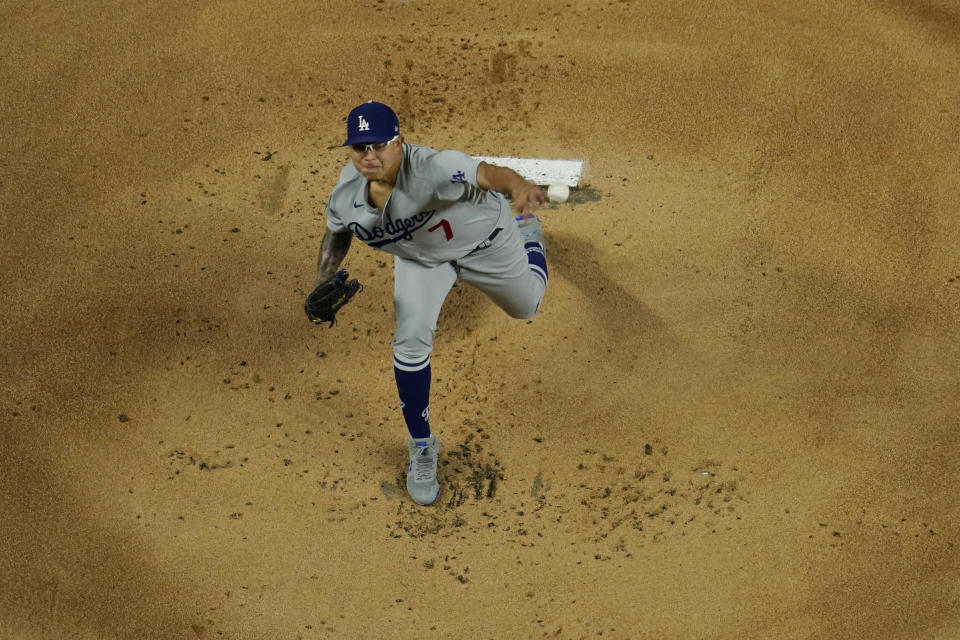 Los Angeles Dodgers starting pitcher Julio Urias throws against the Tampa Bay Rays during the first inning in Game 4 of the baseball World Series Saturday, Oct. 24, 2020, in Arlington, Texas. (AP Photo/David J. Phillip)