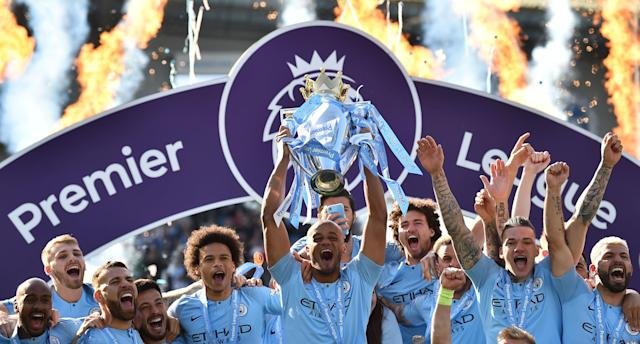 Vincent Kompany holds up the 2018/19 Premier League trophy (Photo by Glyn KIRK / AFP)