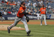 Baltimore Orioles pitcher Jimmy Yacabonis tosses the ball to first base for a force out on New York Yankees' Brett Gardner during the third inning of a baseball game, Saturday, March 30, 2019, in New York. The Orioles won 5-3. (AP Photo/Julie Jacobson)