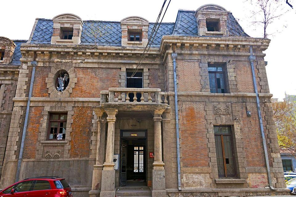 """<p>Known as Chaonei No. 81, this house was completed in 1910 and was reportedly <a href=""""https://www.nytimes.com/2013/09/25/world/asia/dilapidated-mansion-has-had-many-occupants-including-a-ghost.html?smid=fb-nytimes&WT.z_sma=WO_DMH_20130925"""" rel=""""nofollow noopener"""" target=""""_blank"""" data-ylk=""""slk:built by the Qing imperial family as a church for British residents of Beijing"""" class=""""link rapid-noclick-resp"""">built by the Qing imperial family as a church for British residents of Beijing</a>. In 1949, after the Communists defeated the Nationalists in the civil war, a high-ranking Nationalist official who was living there is said to have deserted his wife (or perhaps his concubine), and fled to Taiwan. The woman was so devastated that she hanged herself from the rafters of the three-story mansion, and local residents believe that her spirit has haunted the abandoned home ever since. </p>"""