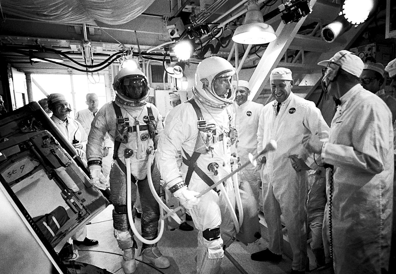 <p>In this June 3, 1966, photo provided by NASA, Gemini IXA astronauts Eugene Cernan, left, and Tom Stafford, center, arrive in the white room atop Launch Pad 19 at Cape Kennedy Air Force Station in Cape Canaveral, Fla. (NASA via AP) </p>