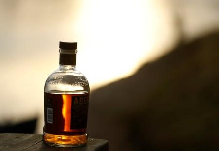 FILE PHOTO: A bottle of whisky is left on the bank as fishing starts on the opening day of the salmon fishing season on the river Tay near Meikleour, Scotland