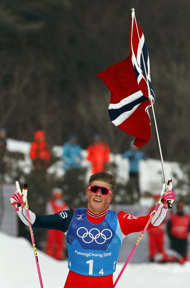 Cross-Country Skiing - Pyeongchang 2018 Winter Olympics - Men's 4x10 km Relay - Alpensia Cross-Country Skiing Centre - Pyeongchang, South Korea - February 18, 2018 - Johannes Hoesflot Klaebo of Norway celebrates. REUTERS/Jorge Silva
