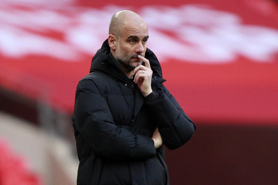 Manchester City's Spanish manager Pep Guardiola looks on during the English FA Cup semi-final football match between Chelsea and Manchester City at Wembley Stadium in north west London on April 17, 2021. - - NOT FOR MARKETING OR ADVERTISING USE / RESTRICTED TO EDITORIAL USE (Photo by Ian Walton / POOL / AFP) / NOT FOR MARKETING OR ADVERTISING USE / RESTRICTED TO EDITORIAL USE (Photo by IAN WALTON/POOL/AFP via Getty Images)