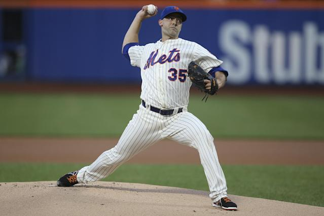 New York Mets starting pitcher Dillon Gee throws in the first inning of a baseball game against the Atlanta Braves on Tuesday, Aug. 26, 2014, in New York. (AP Photo/John Minchillo)