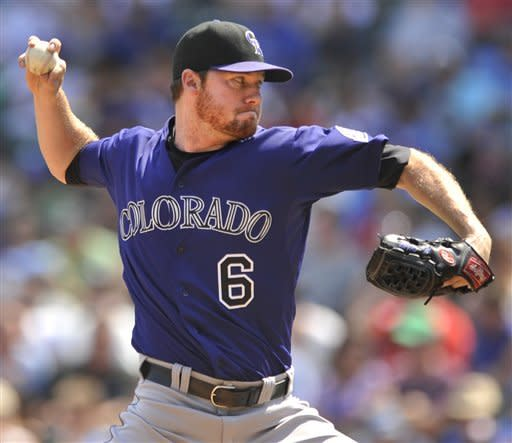 Colorado Rockies starter Alex White delivers a pitch against the Chicago Cubs in the first inning during a baseball game in Chicago, Saturday, Aug. 25, 2012. (AP Photo/Paul Beaty)