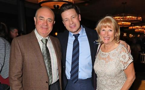 Jamie Oliver with his parents, Trevor and Sally - Credit: Getty