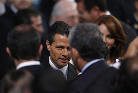 Mexico's President Enrique Pena Nieto talks to the audience after his annual state of the union address in Mexico City