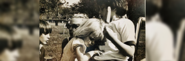 The author as a child hugging her brother, who sits in a wheelchair