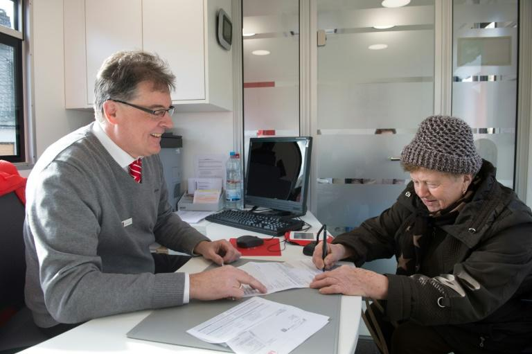 Bank manager Juergen Schaller never expected to end up getting a trucker's licence and driving 20,000 kilometres (12,400 miles) per year bringing banking services to countryside villages