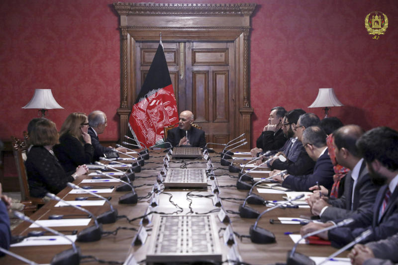 FILE - In this Monday, Jan. 28, 2019, file photo released by the Afghan Presidential Palace, Afghan President Ashraf Ghani, center, speaks to U.S. peace envoy Zalmay Khalilzad, third left, at the presidential palace in Kabul. Khalilzad is in a hurry to find a peace deal for Afghanistan that would allow America to bring home its troops after 17 years of war. The main talks are between Khalilzad and the Taliban's political leadership, which is based in the Gulf nation of Qatar. (Afghan Presidential Palace via AP, File)
