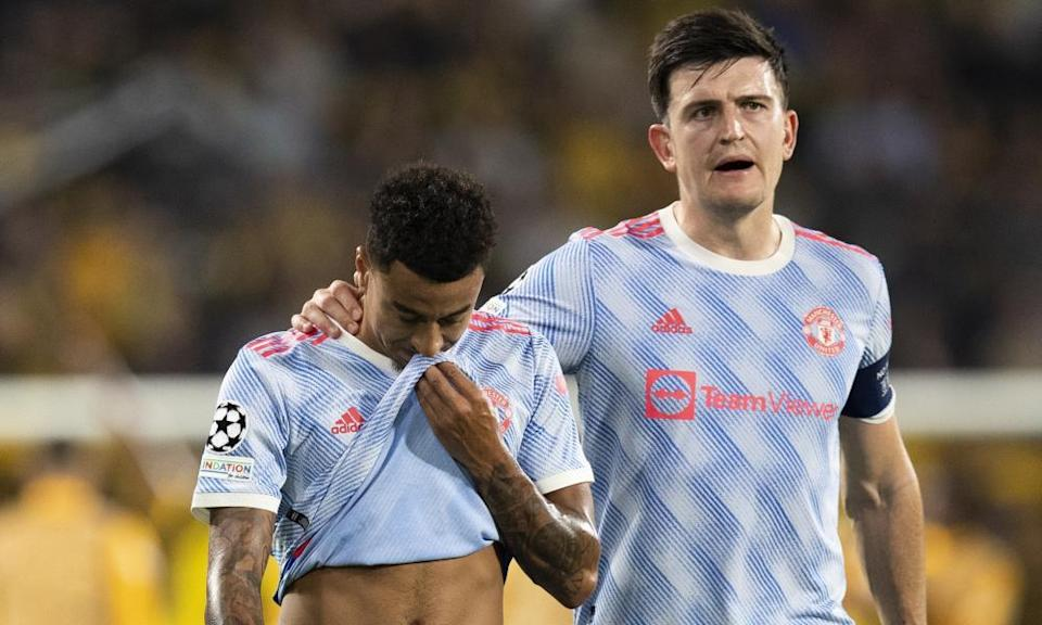 Jesse Lingard (left) is consoled by Harry Maguire following the final whistle after his mistake led to Young Boys' winning goal.