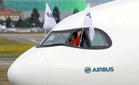 A pilot celebrate in an Airbus A330neo aircraft after its maiden flight event in Colomiers near Toulouse