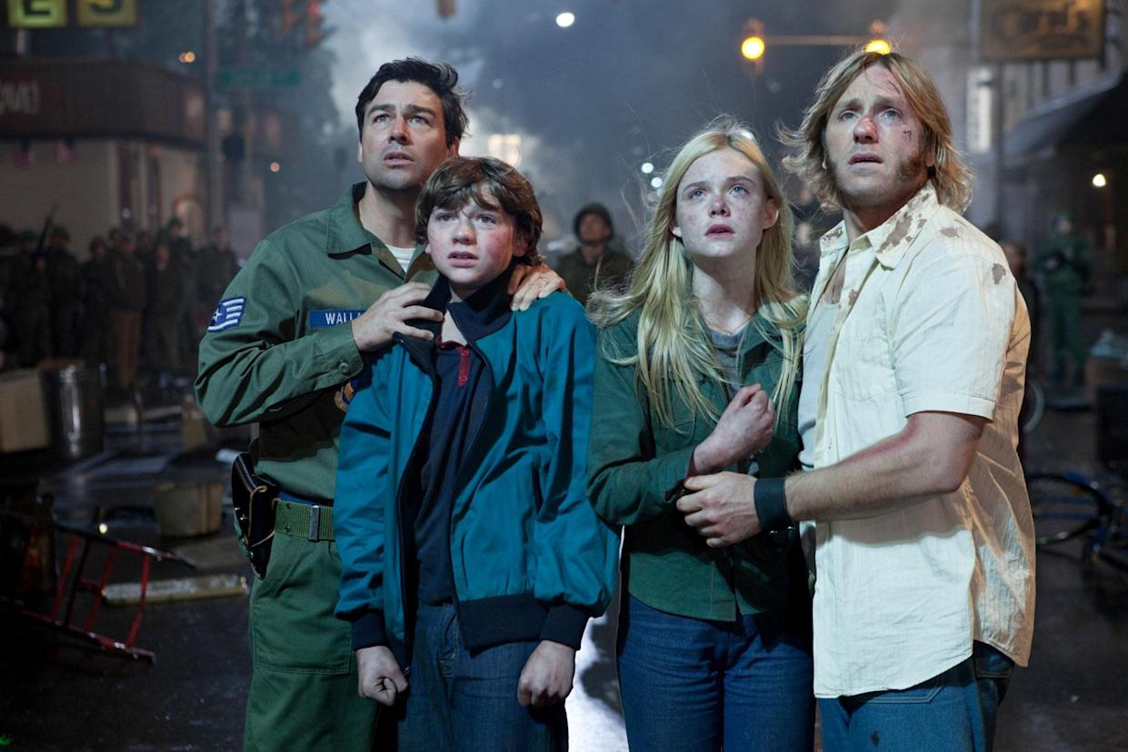 Kyle Chandler, Joel Courtney, Elle Fanning and Ron Eldard appear in the 2011 movie