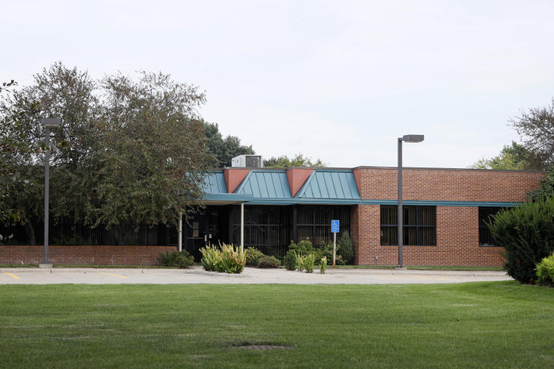 This Monday, Sept. 16, 2019, photo shows an office building in Johnston, Iowa, where the Iowa Communities Assurance Pool is staffed by employees from multiple insurance companies. Board members of the Iowa government insurance program have frequently held public meetings at posh out-of-state resorts, costing taxpayers tens of thousands of dollars while preventing them from attending, a review by The Associated Press shows. (AP Photo/Charlie Neibergall)