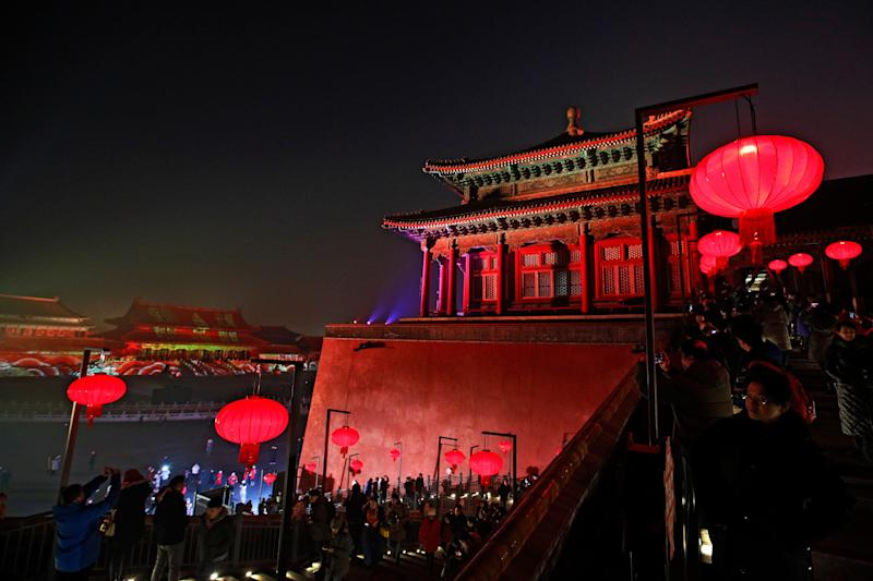 Visitors tour the Forbidden City decorated with red lanterns and illuminated with lights during the Lantern Festival in Beijing, Tuesday, Feb. 19, 2019. (Photo: Andy Wong/AP)
