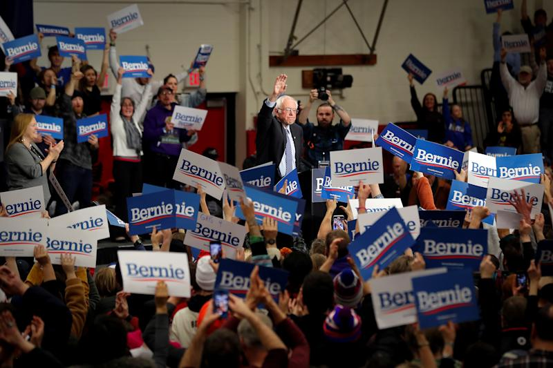 Democratic U.S. presidential candidate Senator Bernie Sanders waves as the is cheered by supporters after speaking during a campaign rally in Keene, New Hampshire, U.S., Feb. 9, 2020. (Mike Segar/Reuters)