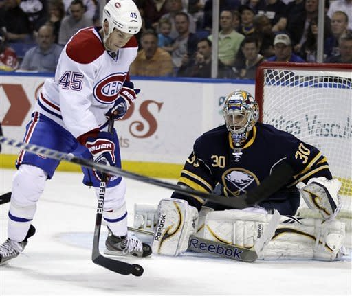 Buffalo Sabres goalie Ryan Miller watches as Montreal Canadiens' Mike Blunden (45) works for a shot during the second period of an NHL hockey game in Buffalo, N.Y., Wednesday, March 21, 2012. (AP Photo/David Duprey)