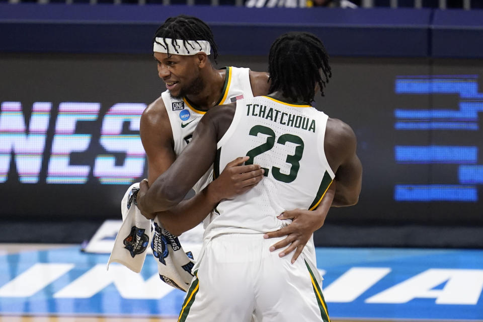 FILE - Baylor forward Flo Thamba, rear, and Jonathan Tchamwa Tchatchoua (23) react to a play against Villanova in the second half of a Sweet 16 game in the NCAA men's college basketball tournament at Hinkle Fieldhouse in Indianapolis, in this Saturday, March 27, 2021, file photo. Tchamwa Tchatchoua and Thamba, the high-energy athletic bigs who do so much inside helping guard-oriented Baylor, first met at a Basketball Without Borders camp in Johannesburg. (AP Photo/Michael Conroy, File)