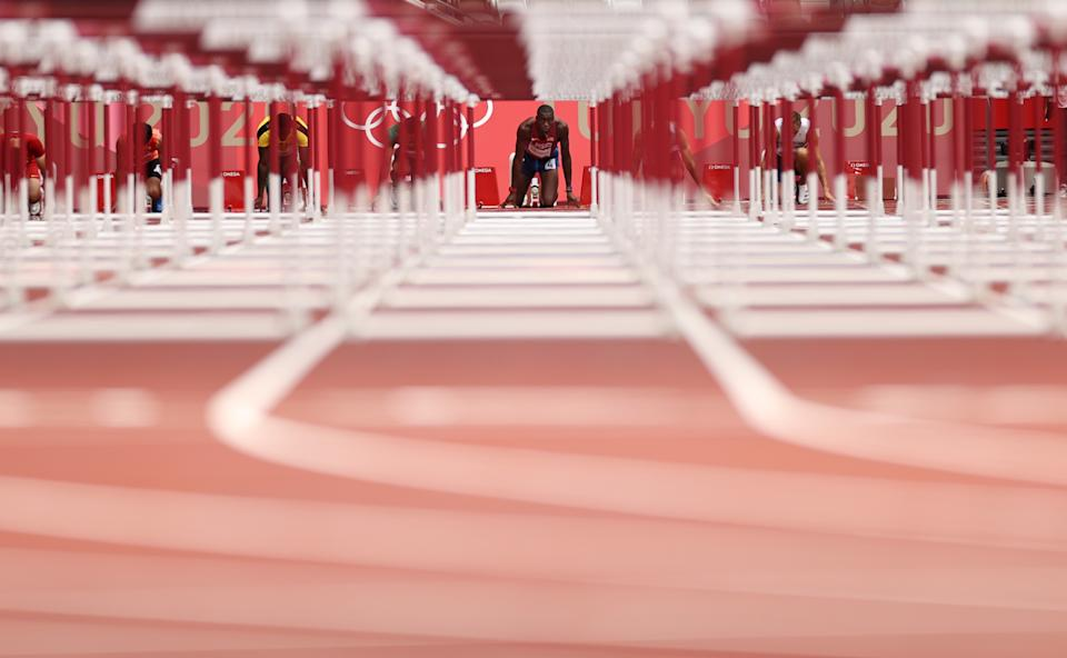 <p>Grant Holloway of Team United States competes in the Men's 110m Hurdles Semi-Final on day twelve of the Tokyo 2020 Olympic Games at Olympic Stadium on August 04, 2021 in Tokyo, Japan. (Photo by Cameron Spencer/Getty Images)</p>