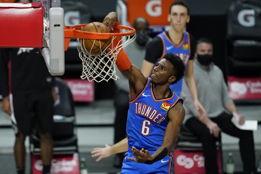 Oklahoma City Thunder guard Hamidou Diallo (6) dunks the ball during the fourth quarter of an NBA basketball game against the Los Angeles Clippers Sunday, Jan. 24, 2021, in Los Angeles. (AP Photo/Ashley Landis)