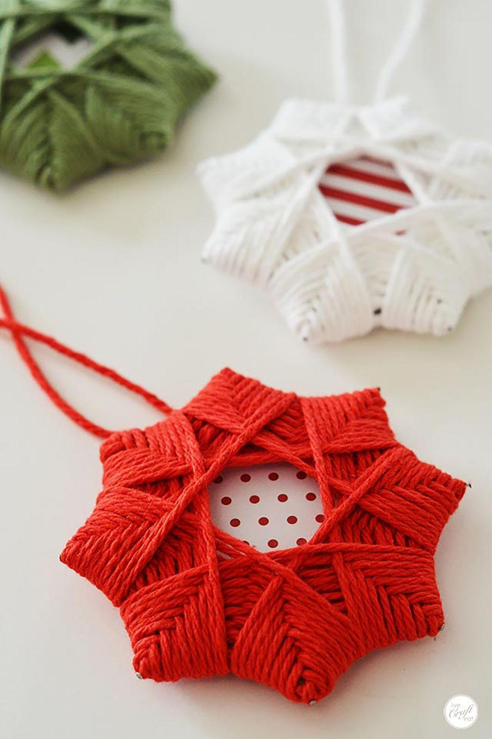 """<p>These cute Christmas star ornaments only require two supplies: festive yarn and pretty cardstock.</p><p><strong>Get the tutorial at <a href=""""http://www.livecrafteat.com/craft/homemade-christmas-tree-star-ornaments/"""" rel=""""nofollow noopener"""" target=""""_blank"""" data-ylk=""""slk:Live Craft Eat"""" class=""""link rapid-noclick-resp"""">Live Craft Eat</a>. </strong><br></p><p><a class=""""link rapid-noclick-resp"""" href=""""https://www.amazon.com/Lion-Brand-Yarn-761-113-Cotton/dp/B017T97ABG/?tag=syn-yahoo-20&ascsubtag=%5Bartid%7C10050.g.1070%5Bsrc%7Cyahoo-us"""" rel=""""nofollow noopener"""" target=""""_blank"""" data-ylk=""""slk:SHOP RED YARN"""">SHOP RED YARN</a></p>"""