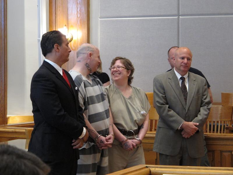 Jeremy Moody, left, talks to his wife, Christine Moody, right, while standing with their lawyers shortly before they were both sentenced to life in prison on Tuesday, May 6, 2014, in Union, S.C. Prosecutors said the couple killed Charles Parker in his home in July 2013 because he was a sex offender and his wife Gretchen Parker because she was there. (AP Photo/Jeffrey Collins)