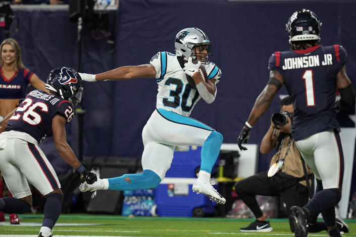 Carolina Panthers running back Chuba Hubbard (30) is forced out of bounds by Houston Texans cornerback Vernon Hargreaves III (26) during the second half of an NFL football game Thursday, Sept. 23, 2021, in Houston. (AP Photo/Eric Christian Smith)