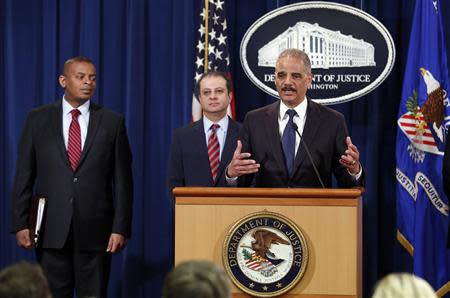 U.S. Attorney General Eric Holder speaks at a news conference at the Justice Department in Washington March 19, 2014. REUTERS/Yuri Gripas