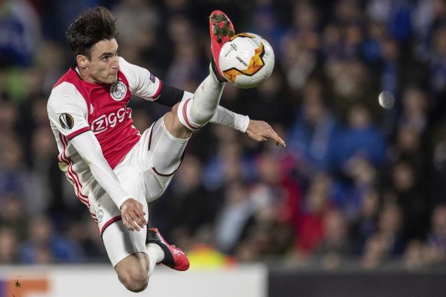 FILE - In this file photo dated Thursday, Feb. 20, 2020, Ajax's Nicolas Tagliafico in action during a Europa League soccer match against Getafe at the Coliseum Alfonso Perez stadium in Getafe, outskirts of Madrid, Spain. The Dutch soccer league was canceled Friday April 24, 2020, because of the coronavirus crisis, but leading team Ajax wont be declared the champion. (AP Photo/Bernat Armangue, FILE)
