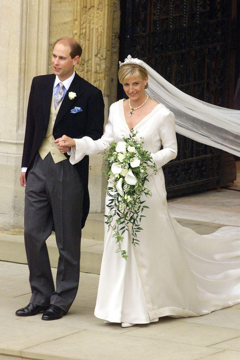<p>The Countess of Wessex married the Queen's youngest son, Prince Edward, in a sleek ivory silk organza gown by Sophie Shaw, which she layered with a matching silk coat. </p>