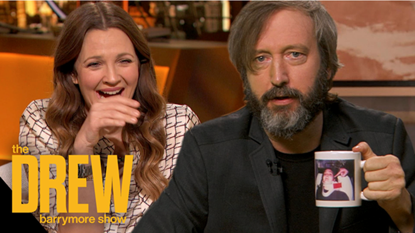 Tom Green surprises Drew Barrymore with his 20-year-old keepsake from their relationship: a mug featuring a photo of Barrymore in a neck brace.