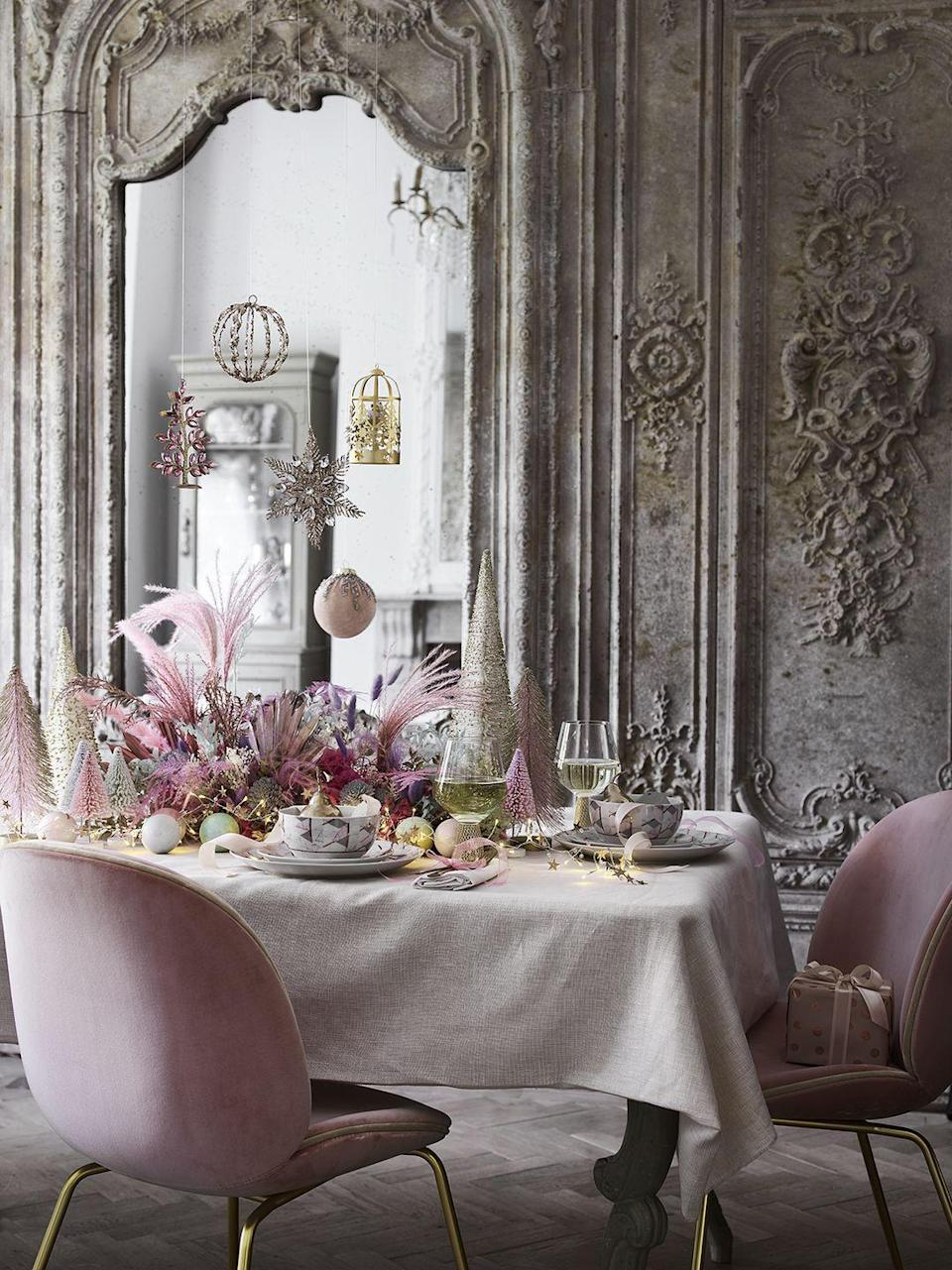 """<p>Combining icy blues with delicate pinks and champagne golds, the contemporary 'Fantastical' trend is all about creating an enchanting feel in every room. Some of the magical <a href=""""https://www.housebeautiful.com/uk/decorate/living-room/g32357518/living-room-accessories/"""" rel=""""nofollow noopener"""" target=""""_blank"""" data-ylk=""""slk:accessories"""" class=""""link rapid-noclick-resp"""">accessories</a> to get your hands on include soft blanket throws, angel baubles, ribbed glass lamps and pink gold glitter trees. </p>"""