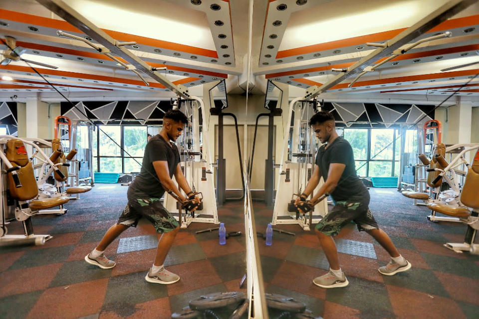 Gym-goers working out at Enrich Fitness centre in Ampang February 12, 2021. — Picture by Ahmad Zamzahuri