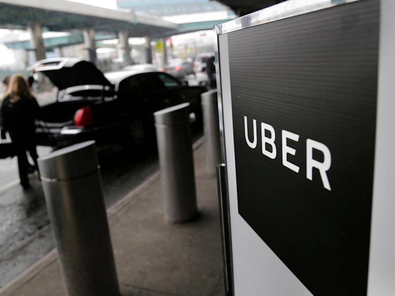 Uber made a loss last year despite revenue from its taxi app growing (AP)