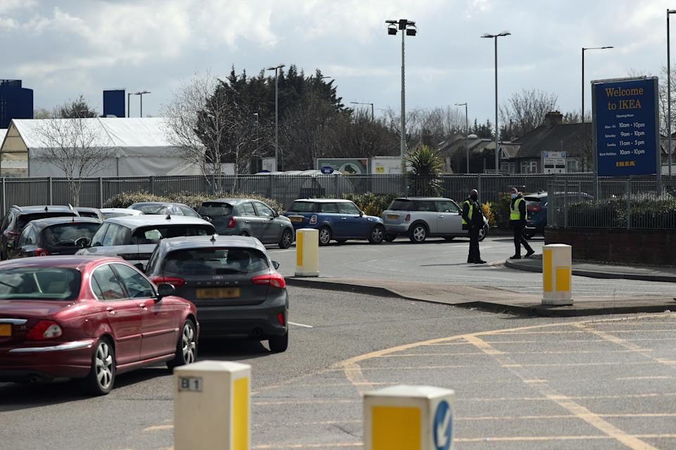 Note to eds: numbers plates pixelated by PA Picture Desk. Stewards organise traffic at a Covid-19 test centre for NHS workers which has opened at Ikea�s store in Wembley, north-west London.
