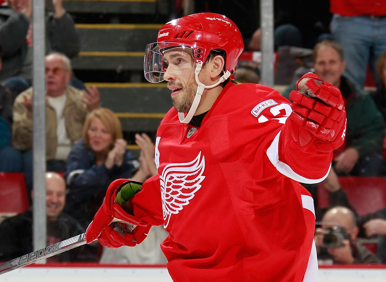 DETROIT, MI - OCTOBER 28: Pavel Datsyuk #13 of the Detroit Red Wings celebrates a second-period assist on a goal by teammate Tomas Holmstrom #96 while playing the San Jose Sharks at Joe Louis Arena on October 28, 2011 in Detroit, Michigan. San Jose won the game 4-2. (Photo by Gregory Shamus/Getty Images)
