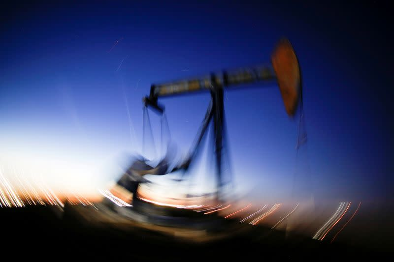 FILE PHOTO: A long exposure image shows the movement of a crude oil pump jack in the Permian Basin in Loving County
