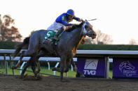 FILE - Jockey Luis Saez rides Essential Quality to win the Breeders' Cup Juvenile horse race at Keeneland Race Course in Lexington, Ky., in this Friday, Nov. 6, 2020, file photo. Essential Quality is expected to be the first grey horse favored to win the Kentucky Derby in 25 years. (AP Photo/Michael Conroy, File)