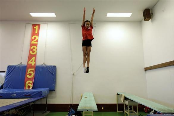 Crystal Palace Diving Club member Victoria Vincent practices during a training session in a dry diving gym in London March 9, 2012.