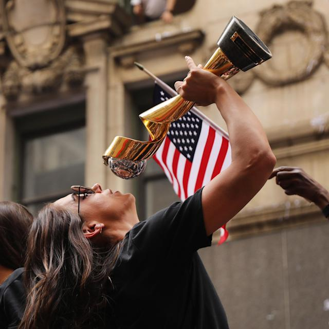 Alex Morgan celebrates with the trophy while riding on a float during the U.S. Women's National Soccer Team Victory Parade down the Canyon of Heroes on July 10, 2019 in New York City. The team defeated the Netherlands 2-0 Sunday in France to win the 2019 Women's World Cup. (Photo by Spencer Platt/Getty Images)