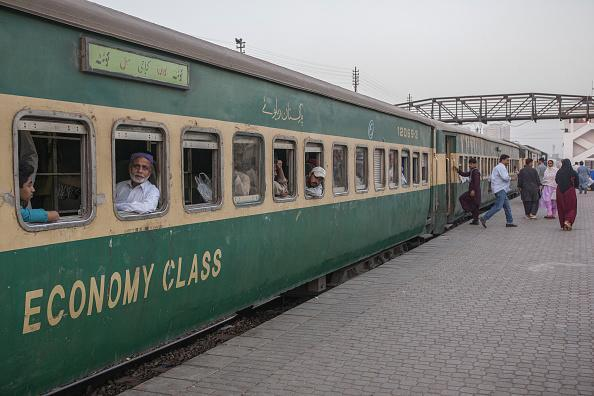 A standard economy class train, operated by Pakistan Railways, sitting at Karachi Cantonment railway station in Karachi, Pakistan. Beijing is set to upgrade a 1,163-miles track from Karachi to Peshawar near the Afghan border with an $8 billion loan to Pakistan. It's part of Chinese President Xi Jinping's Belt and Road trade initiative, which includes $60 billion of badly-needed works financed in Pakistan. Photographer: Asim Hafeez/Bloomberg