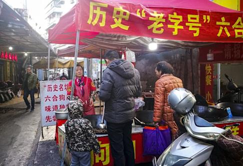 Dog meat for sale at an outdoor eatery in Guilin, advertising its decades-long history. Photo: He Huifeng
