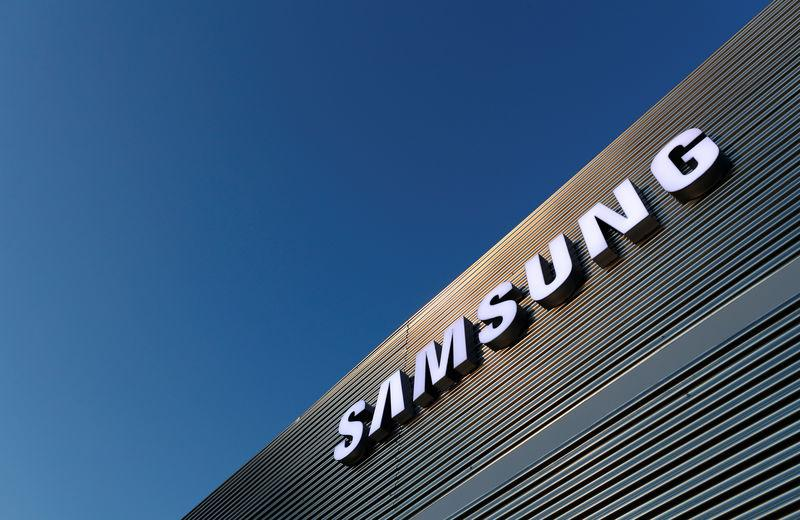 FILE PHOTO: The logo of Samsung is seen on a building during the Mobile World Congress in Barcelona