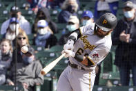 Pittsburgh Pirates' Ka'ai Tom hits an RBI-single during the ninth inning of a baseball game against the Chicago Cubs, Friday, May 7, 2021, in Chicago. (AP Photo/Charles Rex Arbogast)