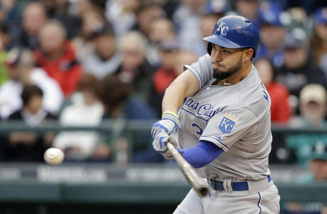 Kansas City Royals' Eric Hosmer singles against the Seattle Mariners in the first inning of a baseball game Friday, May 9, 2014, in Seattle. (AP Photo/Elaine Thompson)
