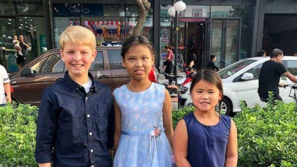 PHOTO: Mia, center, poses in China with two of her adopted siblings. (David and Kerry Mills)